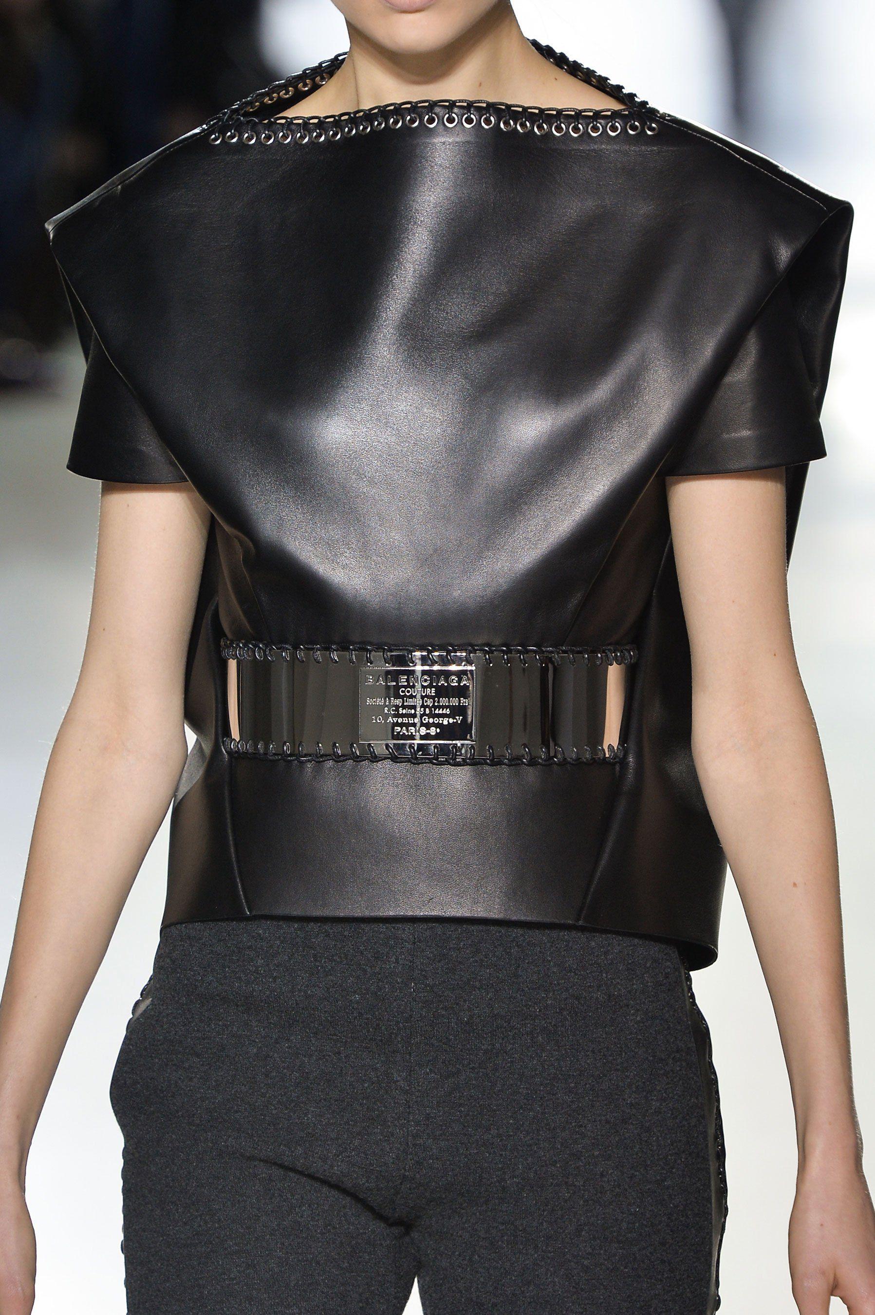 Black leather top with eyelet trim & chrome belt; fashion details // Balenciaga Fall 2014