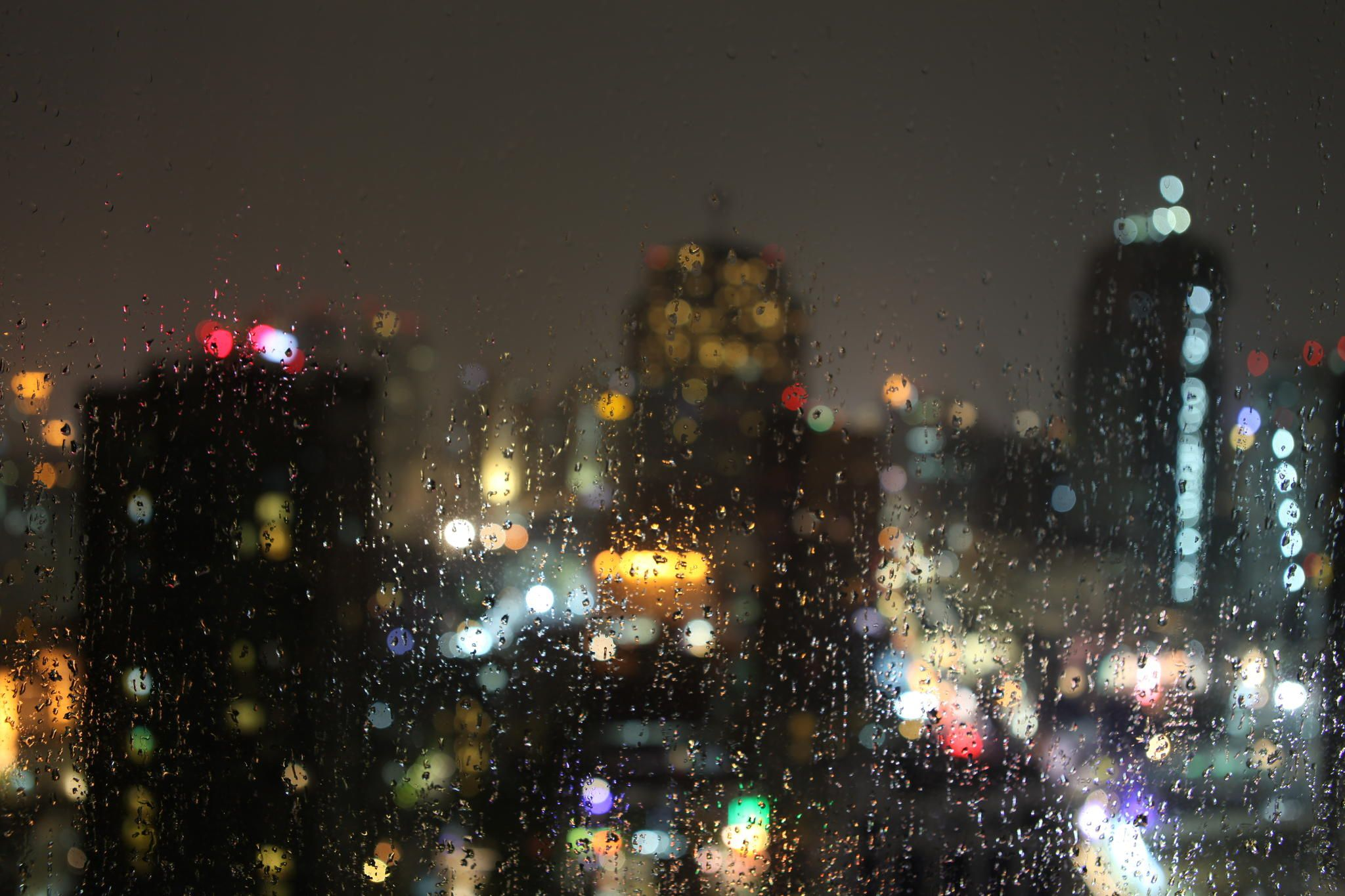 Sky is crying ... - Soft and calm moment of being-angry nature. Photo of raindrop taken from the high building in Bangkok
