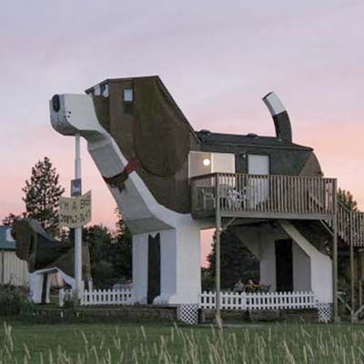Cottonwood, Idaho  This beagle-shaped inn was built in 1997 by chainsaw artists Dennis Sullivan and Frances Conklin, who sold enough chainsaw wood carvings on QVC one year to invest in their pet(!) project. The main building, named Sweet Willy, is accompanied by a 12-foot-high wood carving of another beagle named Toby.