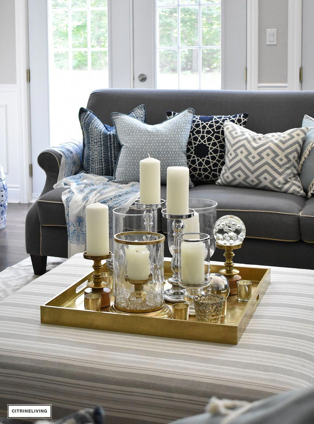 Make A Visual Statement With A Clustered Grouping Of Metal And Glass Candleholders In Varying Heig Coffee Table Decor Tray Coffee Table Table Decor Living Room [ 1459 x 1080 Pixel ]