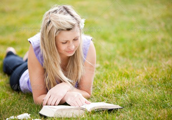 Beautiful woman reading a book in a park ...  adult, attractive, beautiful, beauty, book, bookworm, cute, down, female, garden, girl, grass, green, lady, lawn, laying, learn, leisure, literature, meadow, outdoor, outside, park, people, person, playtime, pretty, read, reading, relax, rest, serenity, sky, smile, smiling, spring, student, study, studying, summer, sunlight, sunshine, woman, young, youth