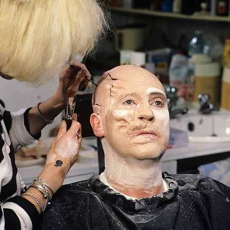 9. Using a dark liner, Ms. Hicks starts the tedious process of outlining the highlights and low lights of the face.