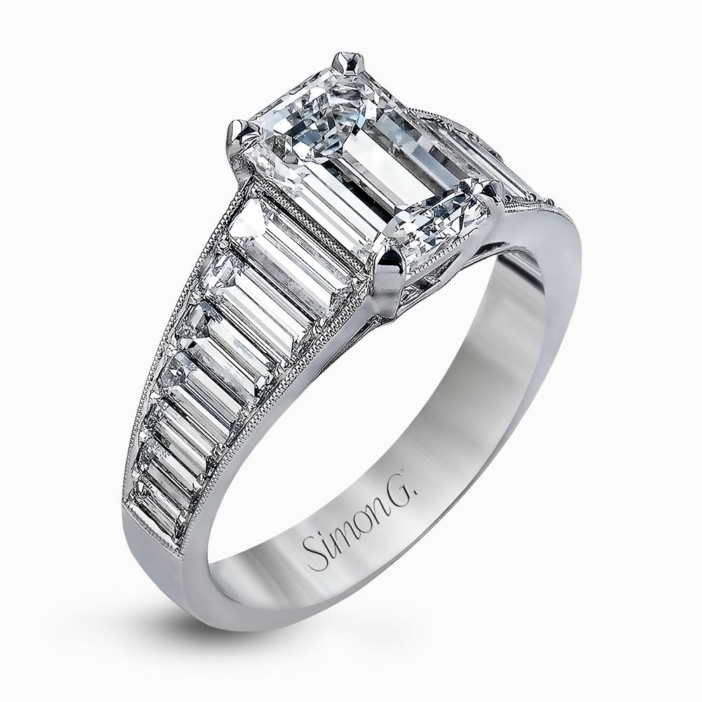 Presenting a thoroughly modern design, this impressive white gold engagement ring features 1.64 ctw of sparkling white baguette cut diamonds.