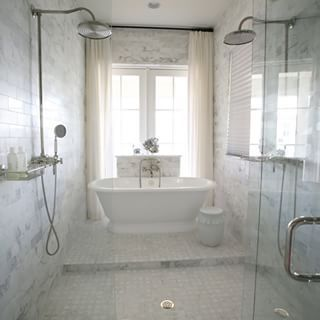 Beautiful shower/soaking tub area, double shower heads, marble...