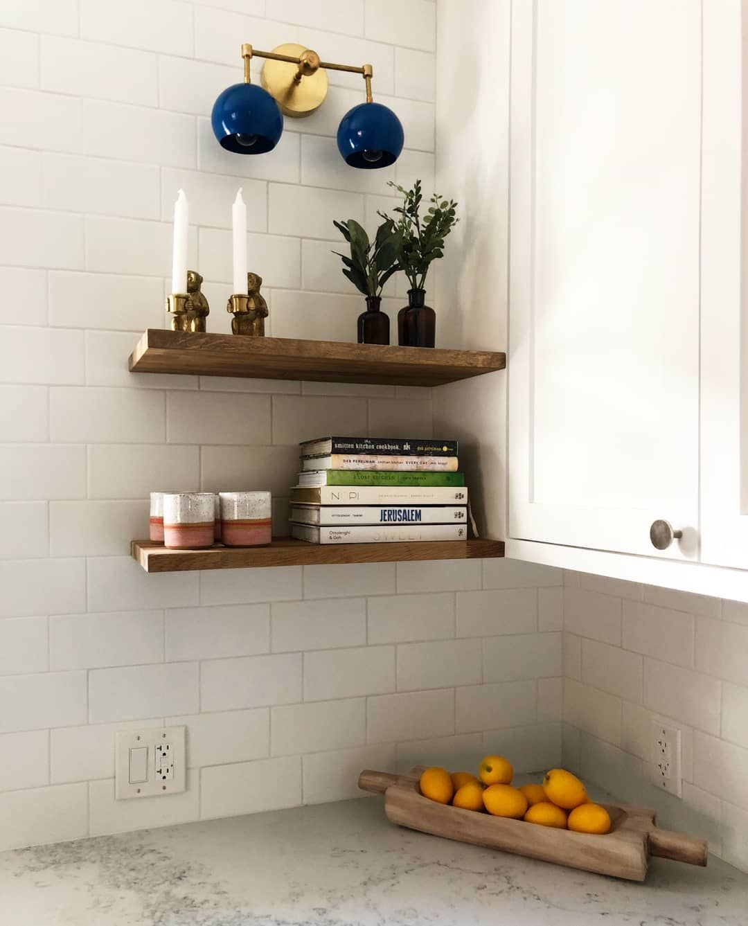 Colorful Wall Sconce In This White Kitchen With Wood Floating
