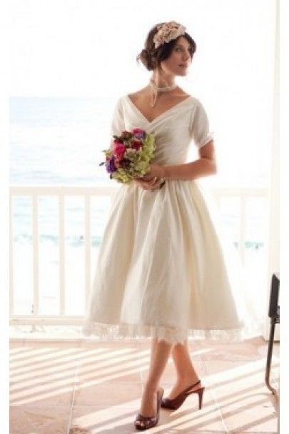 Wedding dress webshop | DollyCouture - White vintage inspired wedding dress with sleeves.