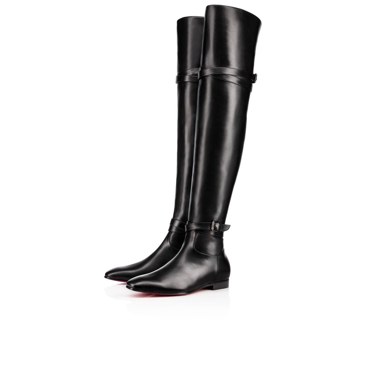9140285f4fa ... thigh-high black leather boots with equestrian wrap-around buckle strap  detail at the ankle and knee and an interior side zip