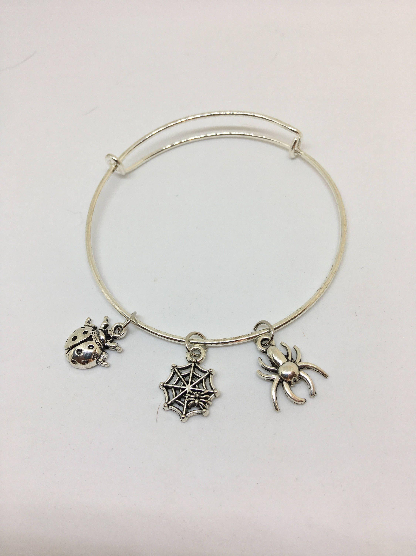 Spider charm bangle bracelet by Pinkarrowheadranch on Etsy https://www.etsy.com/listing/525022021/spider-charm-bangle-bracelet