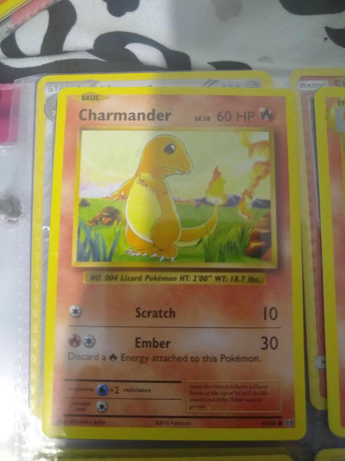 Charmander evolutions base card and 1 random fire energy