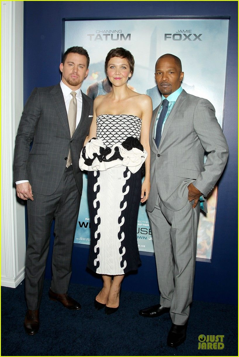 Maggie is wearing a Christian Dior dress and Christian Louboutin shoes at the White House Down premiere in NYC. She poses on the blue carpet with her co-stars Channing Tatum and Jamie Foxx