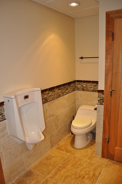 Urinal And Toilet In The Basement Bathroom Basement Bathroom Remodeling Inexpensive Bathroom Remodel Bathrooms Remodel