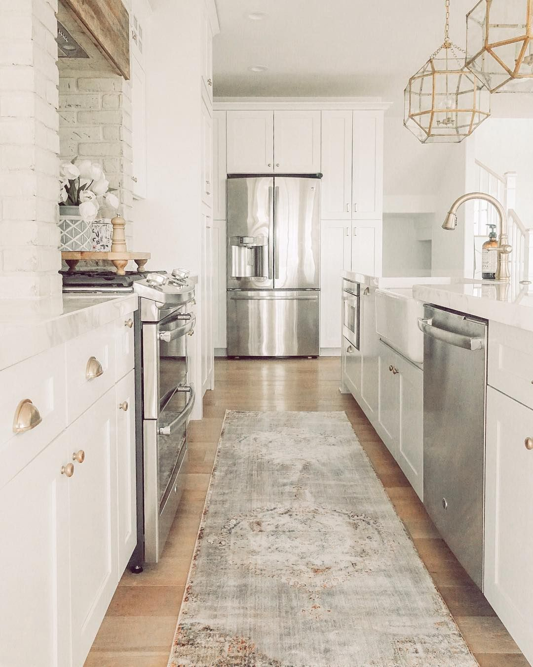 white kitchen with brass pendants and hardware kitchen