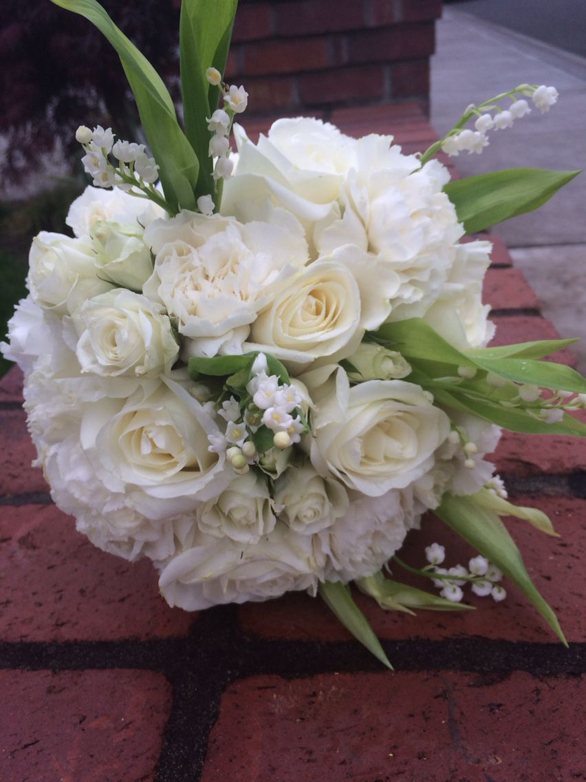 Wedding brides bouquet with white roses lisianthus and lily of the wedding brides bouquet with white roses lisianthus and lily of the valley izmirmasajfo