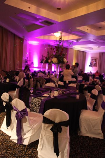 Black table cloth purple satin runner w/ damask overlay. With different wall draping and centerpieces. & PEC: White chair covers w/ all purple bows (but bigger/fuller ...