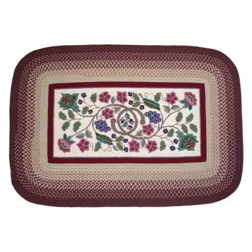 Rhody Rug Braided Hook Vineyard Rug Size - 10 x 13 ft. by Rhody Rug. $1029.99. Vacuum regularly, surface shampoo, dry flat. Finely crafted with a combination of techniques. Hooked floral pattern framed by braided border. Your choice of rug size. 85% wool, 15% poly fiber. Add a touch of warmth and traditional flair to your home with the Rhody Rug Braided Hook Vineyard Rug. This rectangular rug's hooked center floral design is accented by a crimson braided border - a traditional lo...
