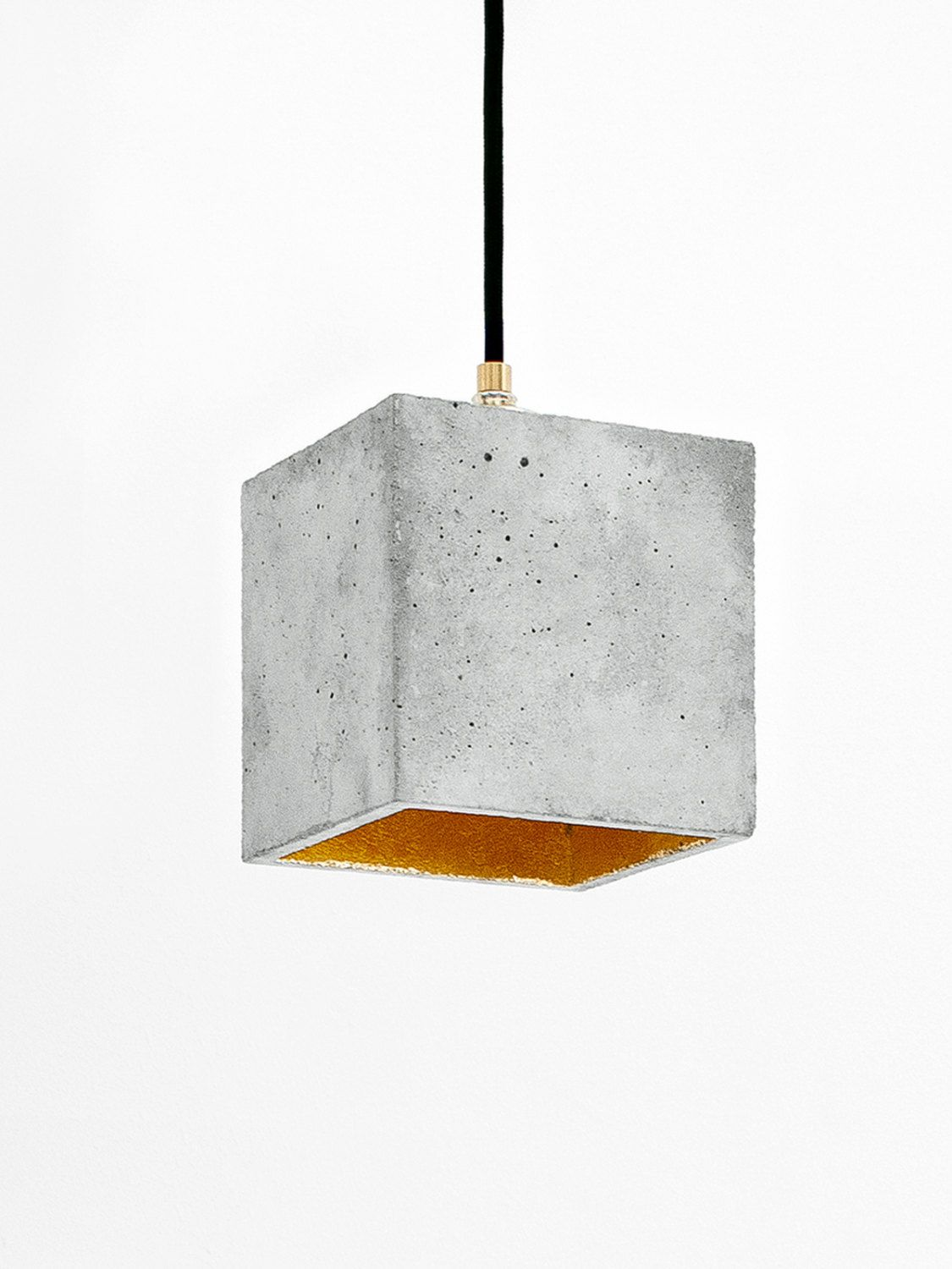 [ The Cubic Hanging Lamp [ Is Cast From A Light Gray Concrete. It Combines  Noble Gold With Rough Concrete Into A Timeless And Elegant Designer Lamp .