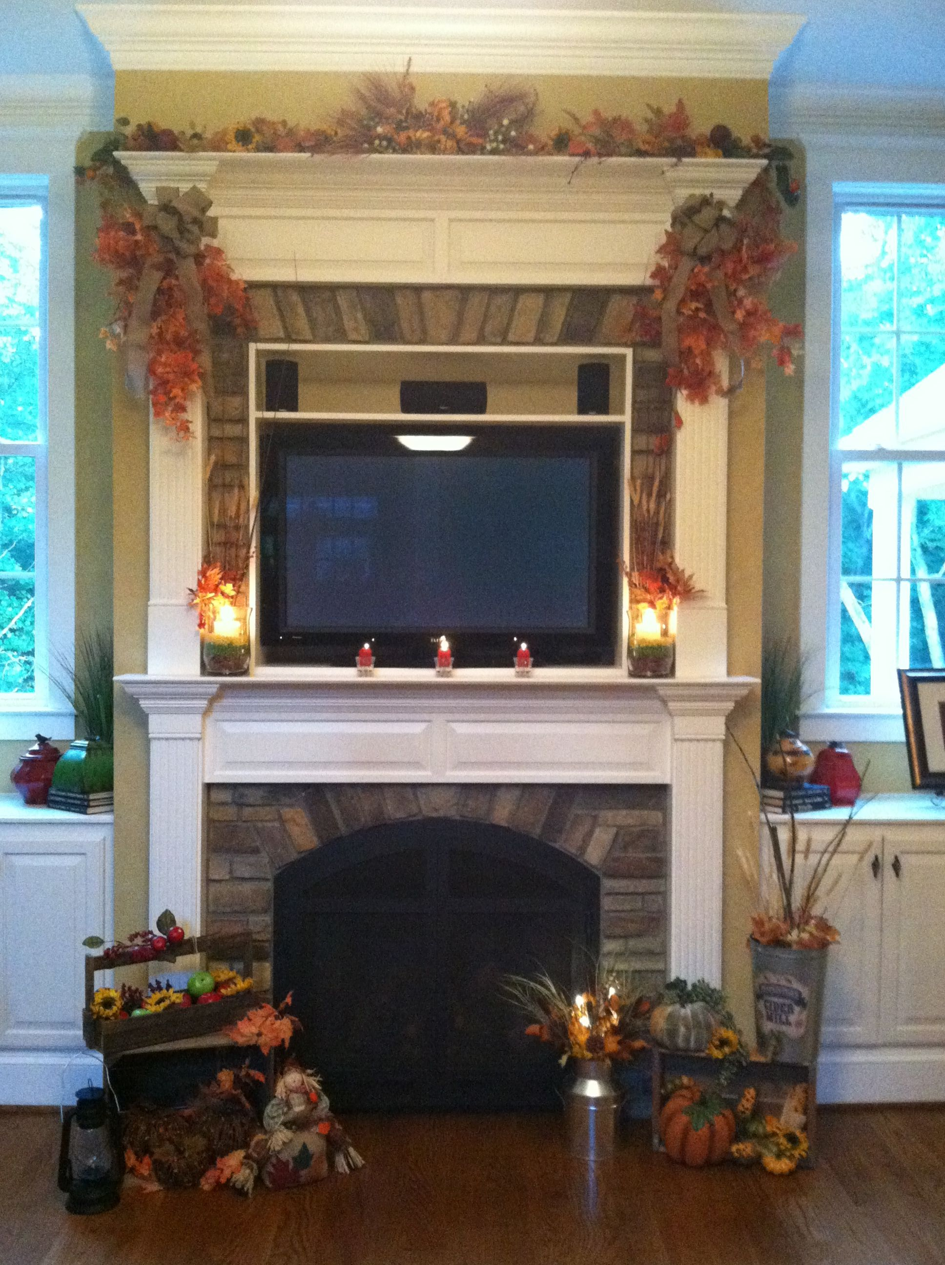 Mantle.  Fall decorations. Doesn't interfere with the football viewing. Mantle decorations. Fall