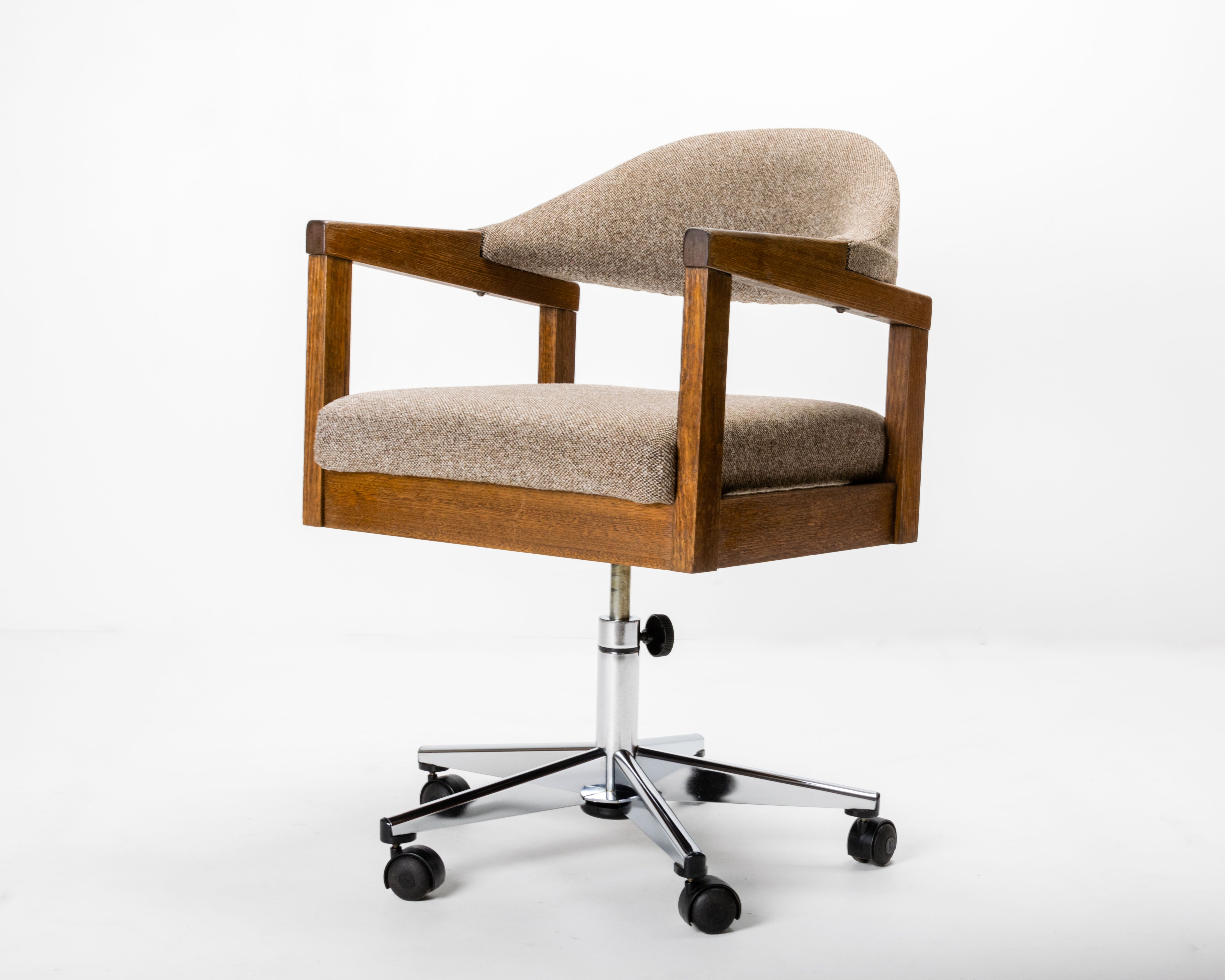 Handsome c1960s swivel armchair with a generous seat