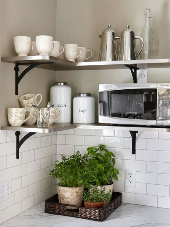 Amazing Open Kitchen Shelving Tips And Inspiration: Contemporary Stainless Shelves  With Black Iron Brackets, White Subway Tile Backsplash. Plants In Basket  Tray