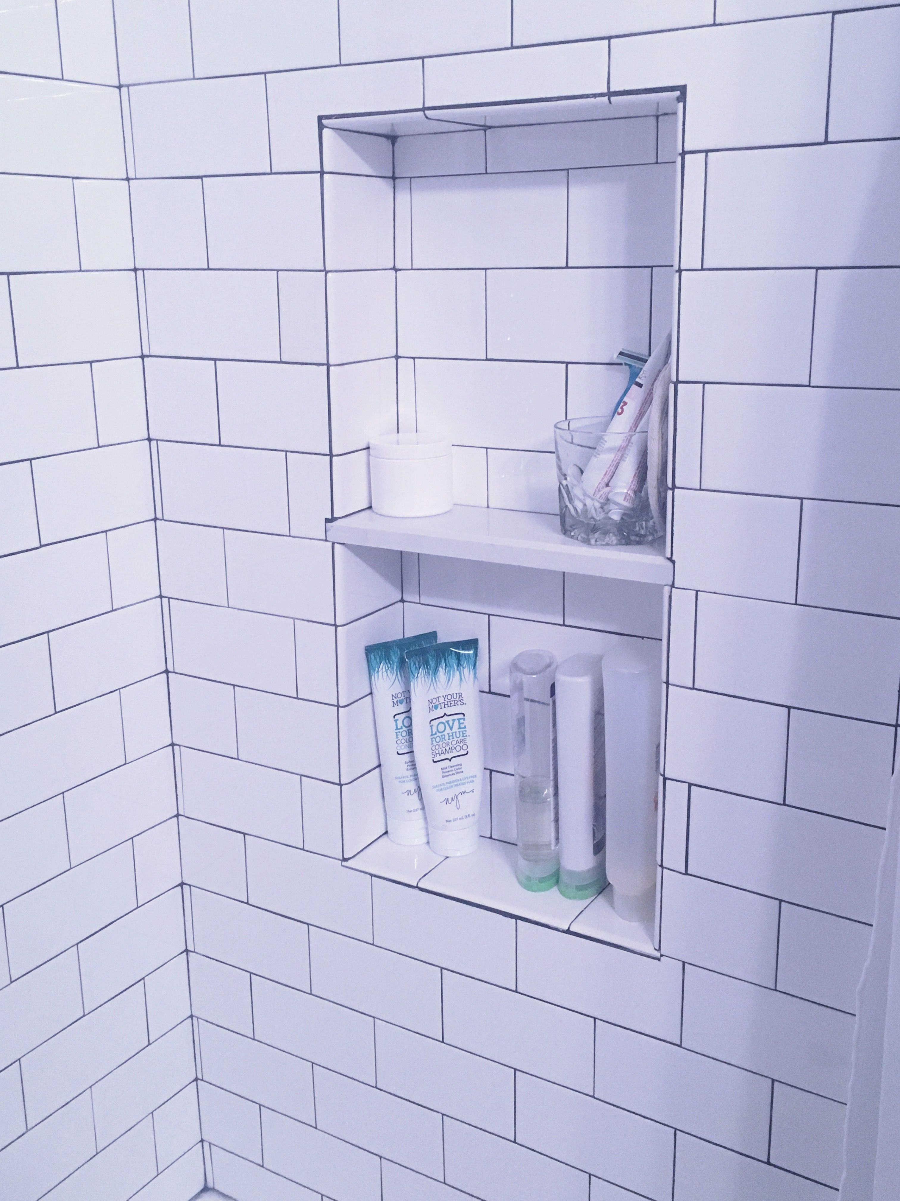Classic white subway tile with charcoal grout and white marble ...