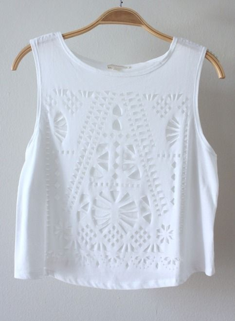 Soft white crop tank with laser cut pattern details on front.  Measurements from a Size SMALL (Add half inch for each size up) Length: 18.5 inches Bust: 12 inches  100% Cotton Imported