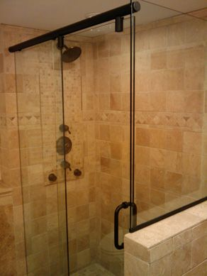 Bathroom Knee Wall image of a frameless shower door with knee wall return panel and