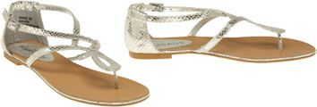 Rampage curved T-strap sandal is constructed of silver tone, textured faux leather, embossed with a snake skin pattern. The back of the sandal has a heel-cup finish and secures at the ankle with an adjustable buckle.