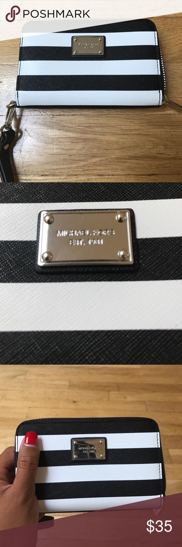 1278e072bfb1 Black   White Striped Michael Kohrs Wristlet