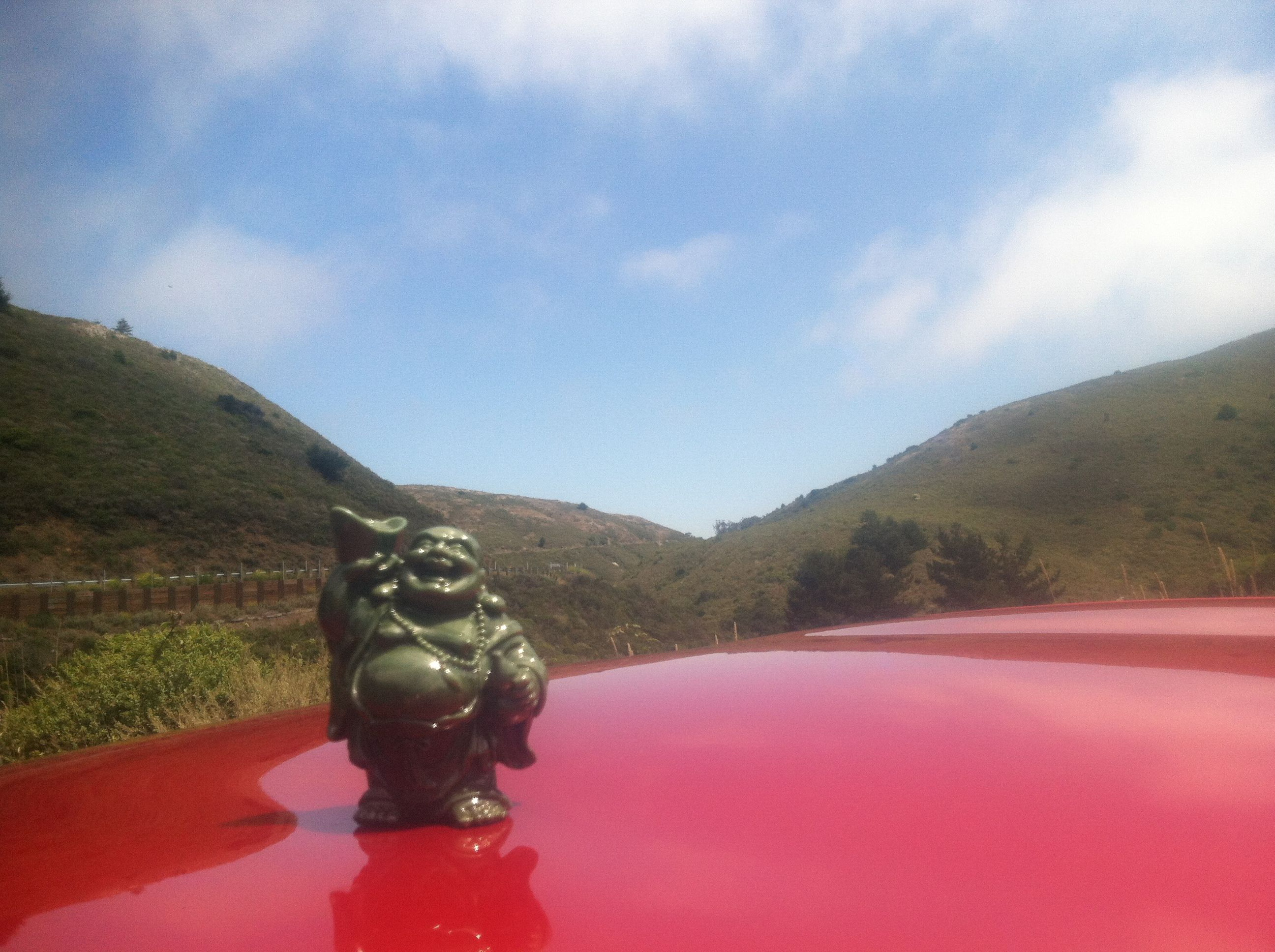 A traveling Buddah.   Take a small item that is special to you and take a picture with it where you go!