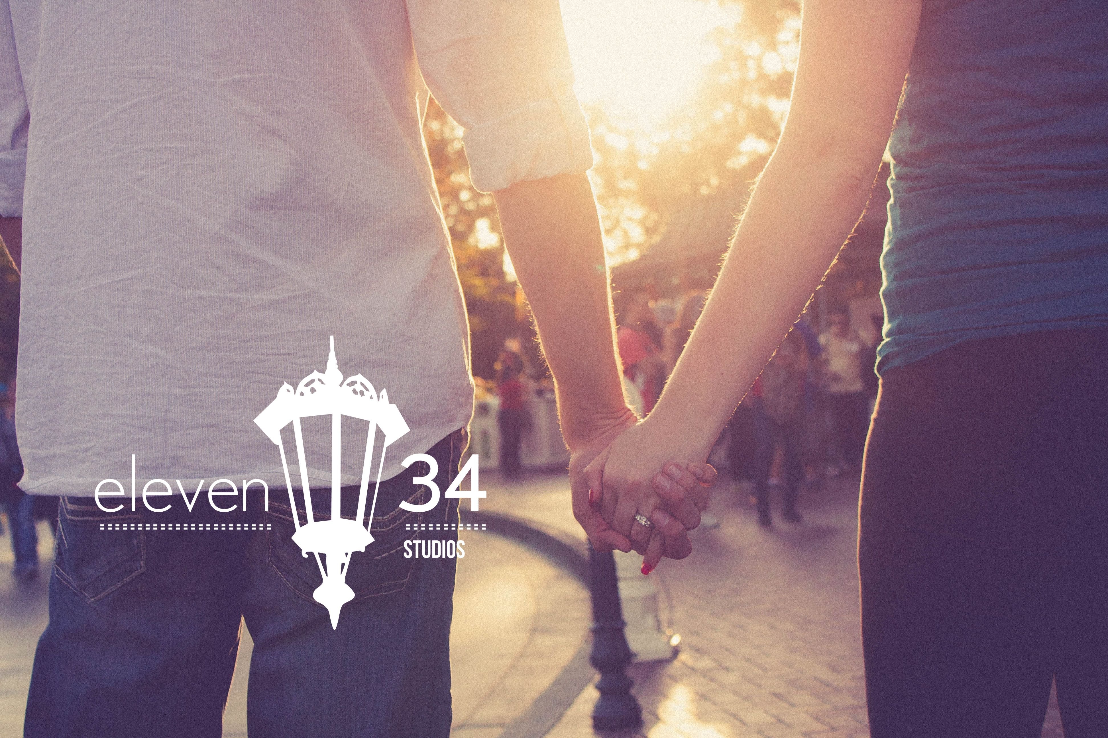 Post proposal, holding hands and walking at sunset through the crowds