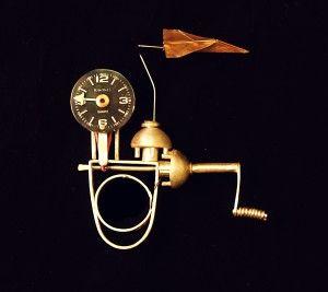 Sarah Doremus kinetic ring  http://ganoksin.com/blog/sarahdoremus/files/2008/10/time-flysp1293435-300x267.jpg