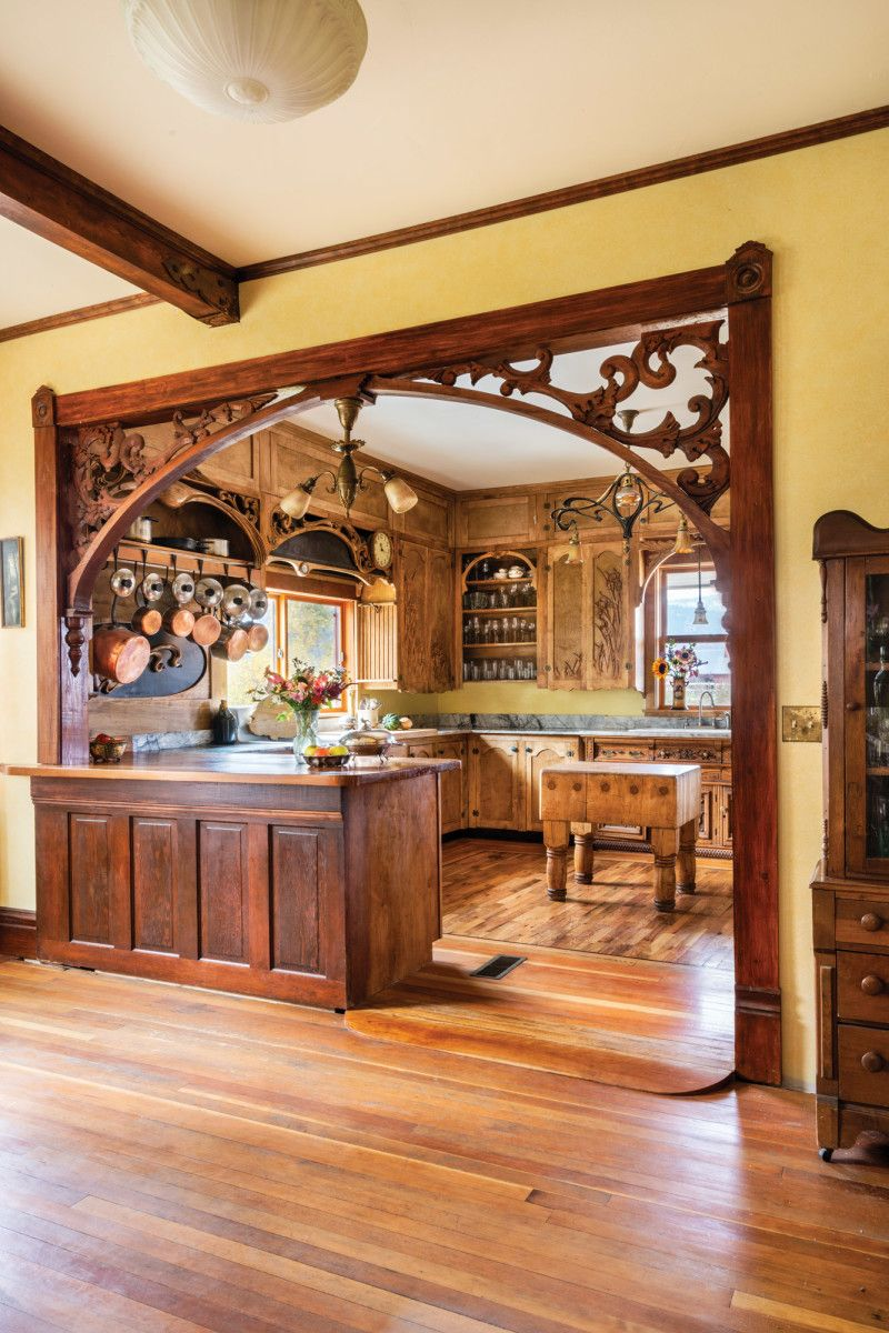 The main kitchen is semi enclosed behind a fretwork embellished ...