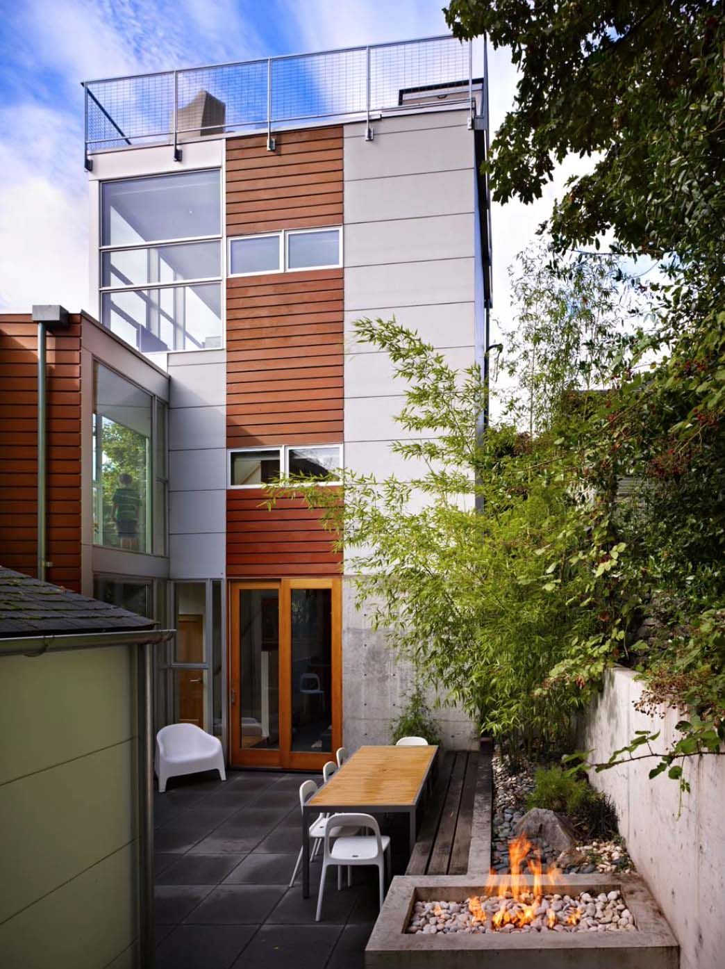 striking three-story modern dwelling in seattle with a rooftop