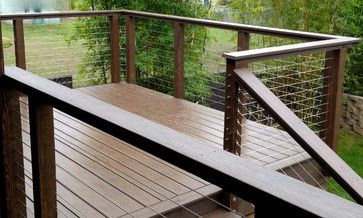 Turning Corners With Cable Rough Sawn Wood Posts With Pvc Top Railings Complete Wooden Kits Available Steve Sherritt Modern Fence Modern Deck Home Fencing
