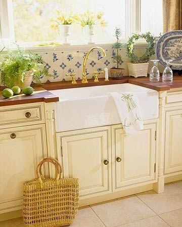 Cottage Kitchen with Farmhouse Sink  A white cast iron farmhouse