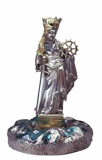 A gilded silver figure of Saint Catherine of Alexandria/Heilige Katharina, made in Cologne/Köln, c.1380; she holds her symbolic attributes of a sword and a wheel and wears a crown, symbol of martyred glory. (Museum Schnütgen)