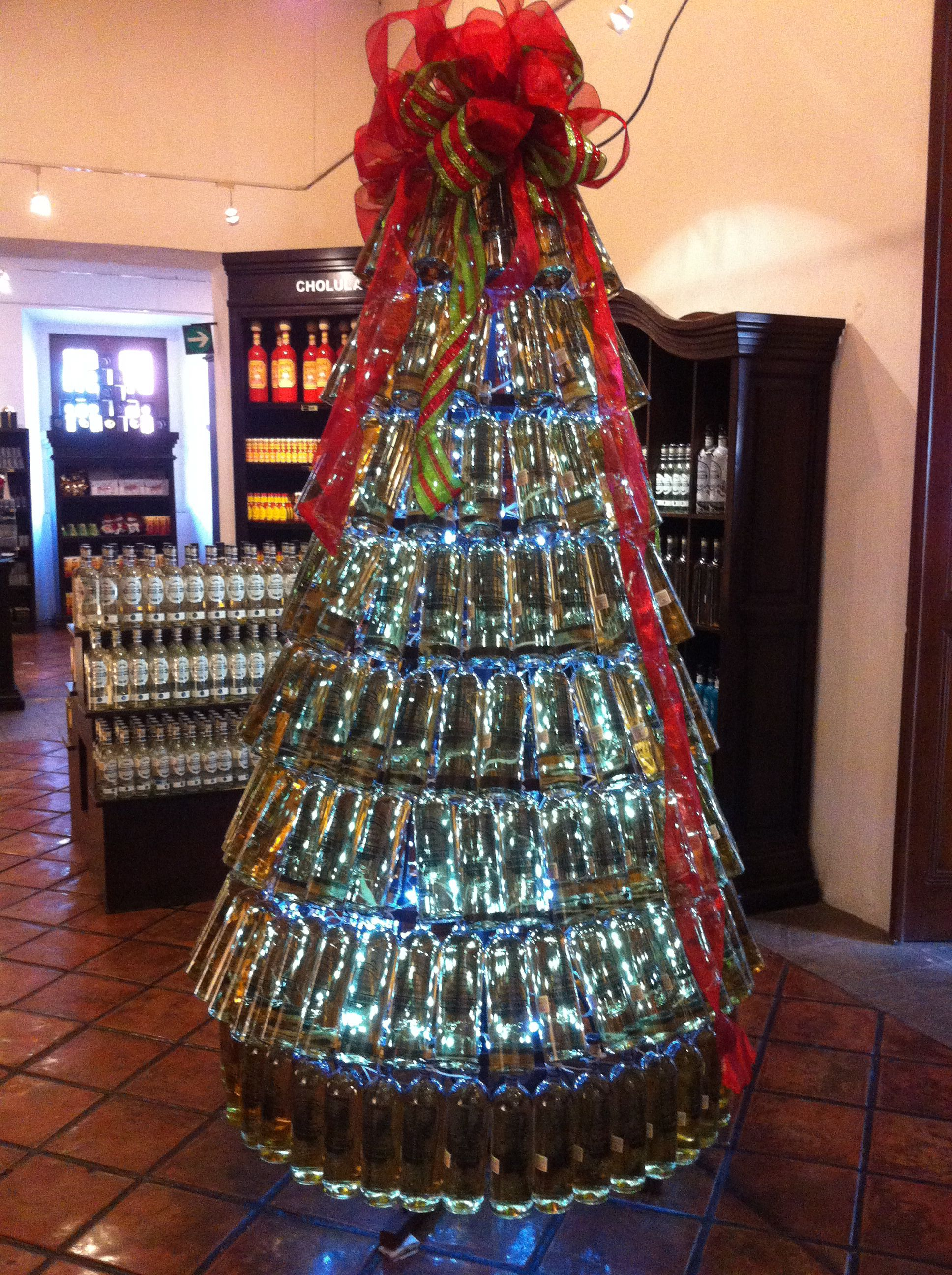 A Christmas Tree Made With Tequila S Bottles At Mundo