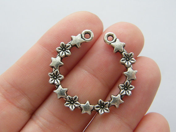 4 Star and flower garland charms antique silver tone S101