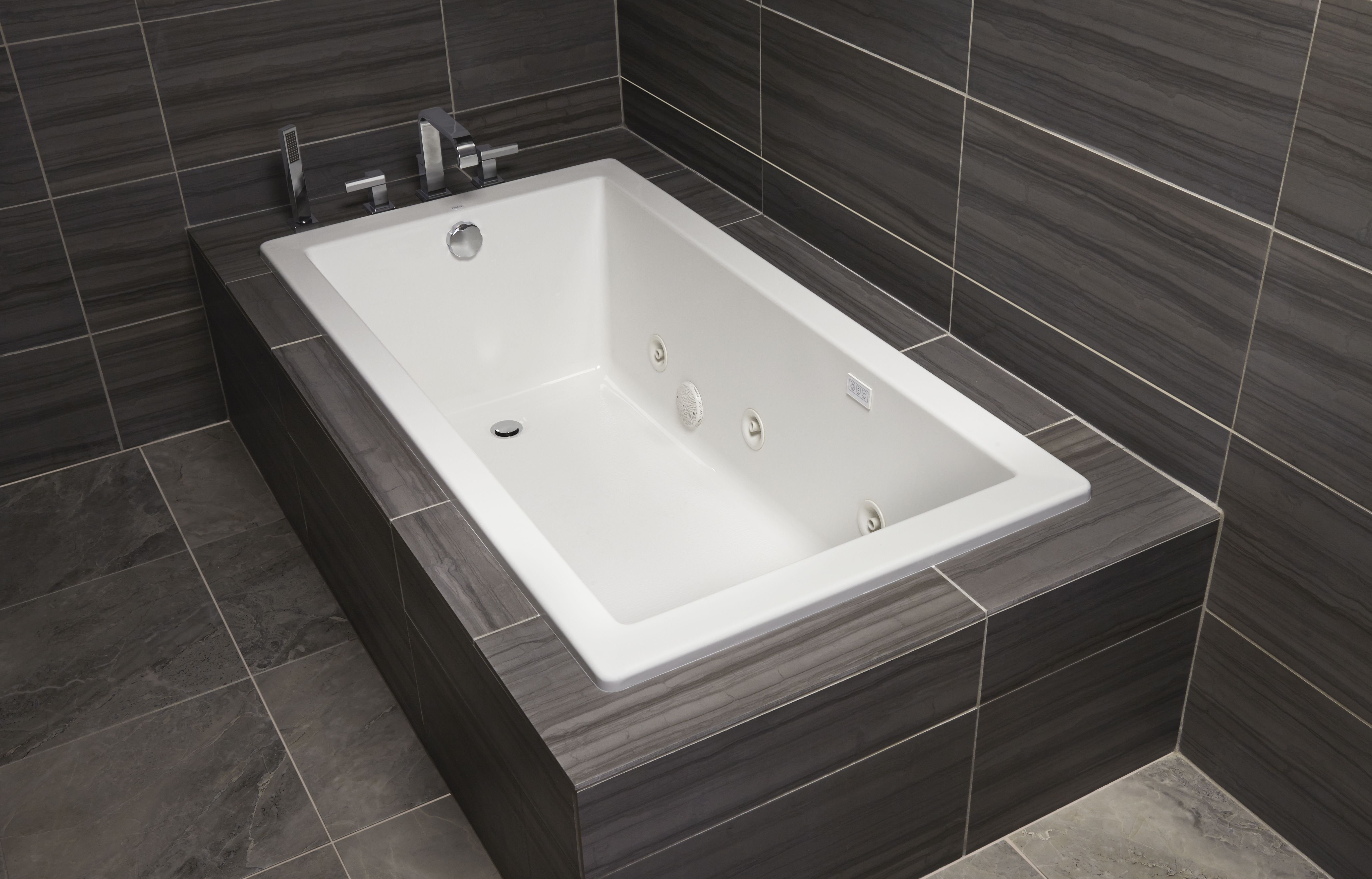 Clean lines and architectural styling give the Mirabelle Sitka tub ...