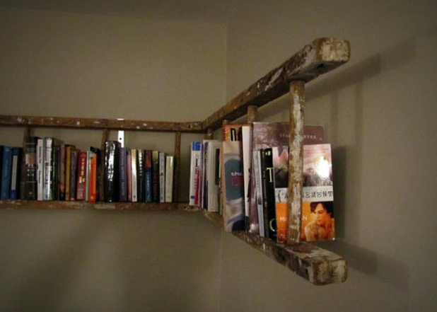 Shelving idea ... this rickety old ladder makes quite the focal statement for any room.