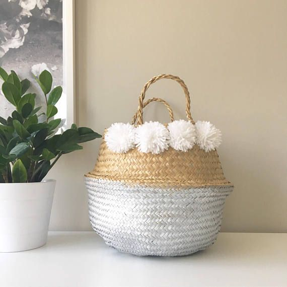 100% natural handwoven Vietnamese seagrass baskets from Kit + Loom. Known as belly baskets they are flexible, foldable, yet incredibly sturdy, and that makes them great as a plant pot, bathroom towel storage, or to hold kids toys and lego. The pom poms are handmade by Kit & Loom, and the