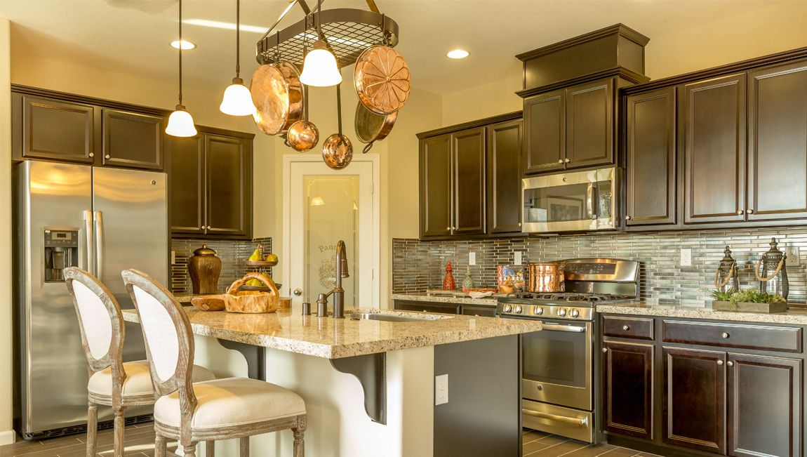 gorgeous grey dark stained cabinets in this beautiful drhorton kitchen dark stained on r kitchen cabinets id=66848