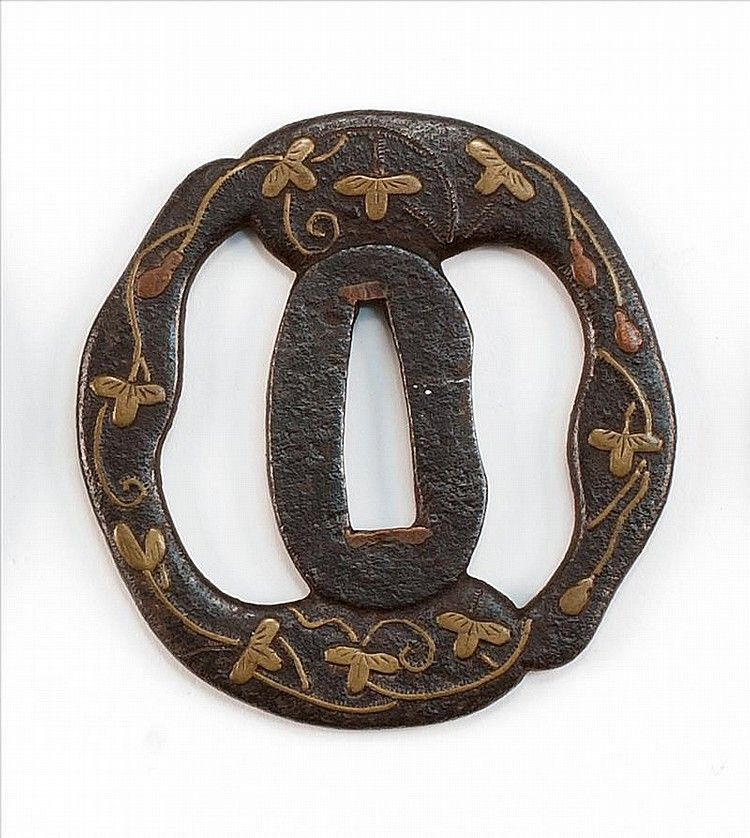 "INLAID IRON TSUBA 16th/17th Century In irregular form with openwork gourd design. Highlighted in brass and copper with leaves and vines. Length 3"" (7.5 cm)"