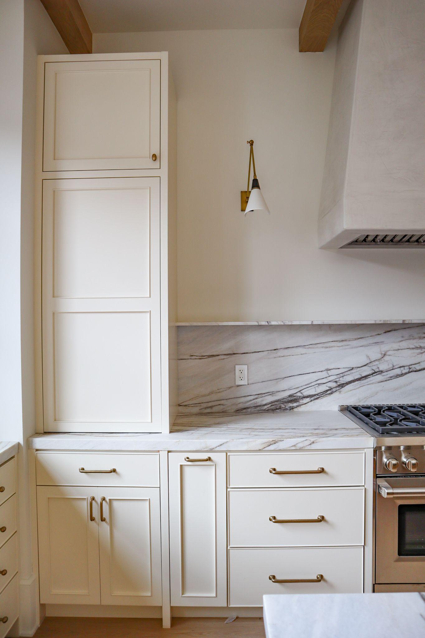 Stunning backsplash shelving and plaster range hoo