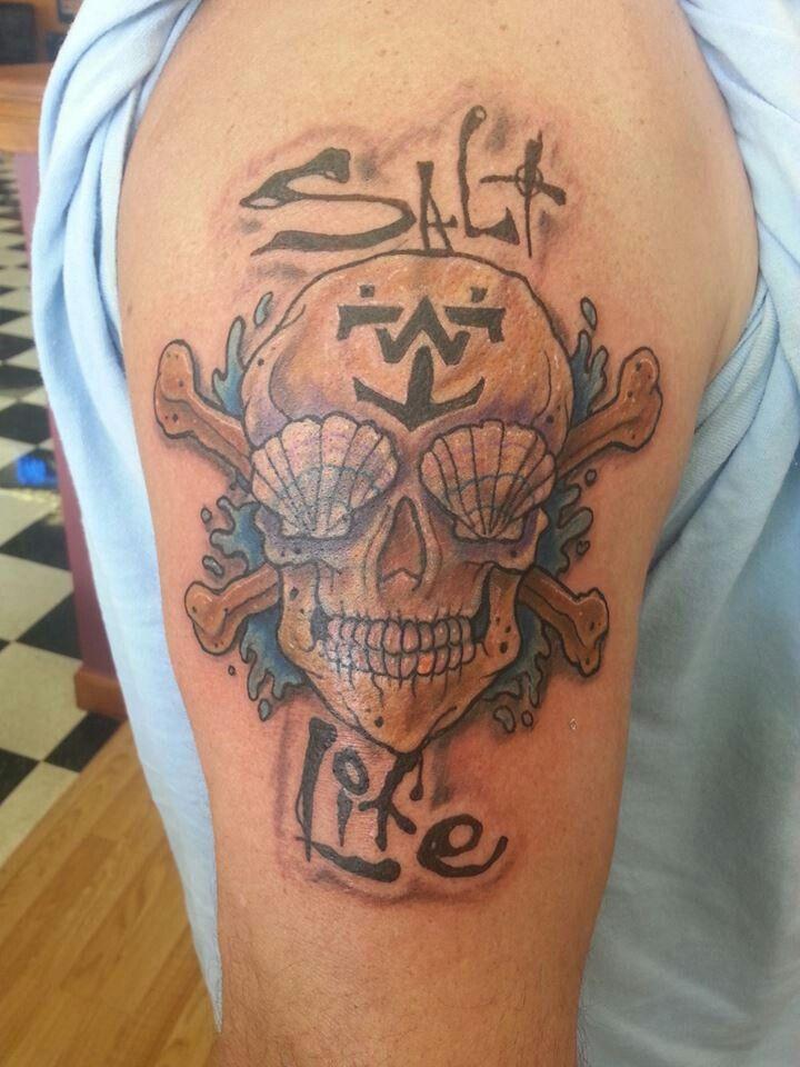 Salt life skull and crossbones by artist paulie thrasher for Blue horseshoe tattoo