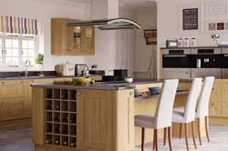 Kitchen Units In An Oak Shaker Style And A Modern Setting