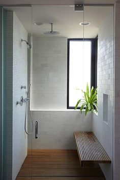 Love This Shower. White Tile, Wood Floor, Wood Bench / Simple Spaces For  Stuff / Shower Coming Out Of Wall And Ceiling. Bathroom Bench And Wood Slat  Floor.