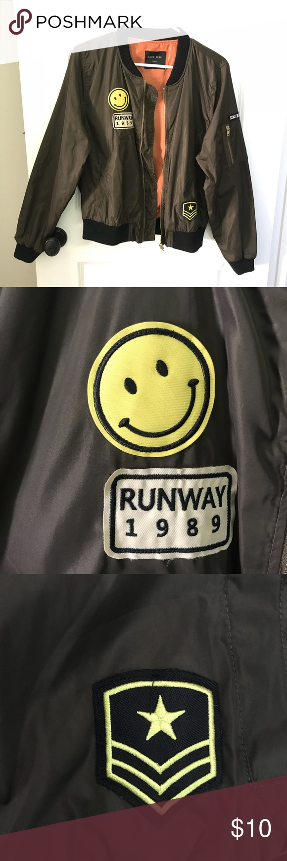 755fe2f0078 Bomber Jacket w  Patches An olive green bomber jacket with super cute  patches! Lined on the inside in orange. Would look great styled with jeans.