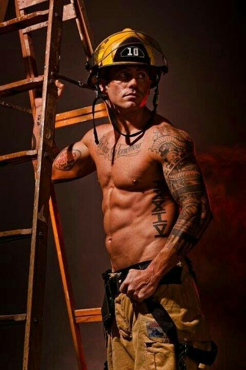 Australian firefighters pose with animals for charity, and the photos are so hot it may start fires