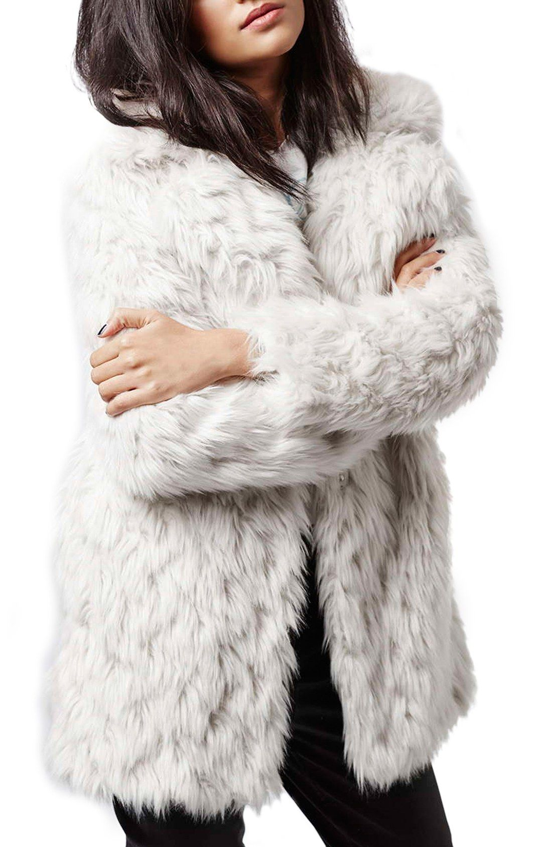 This oversized shaggy faux-fur coat finished with cozy pockets ...
